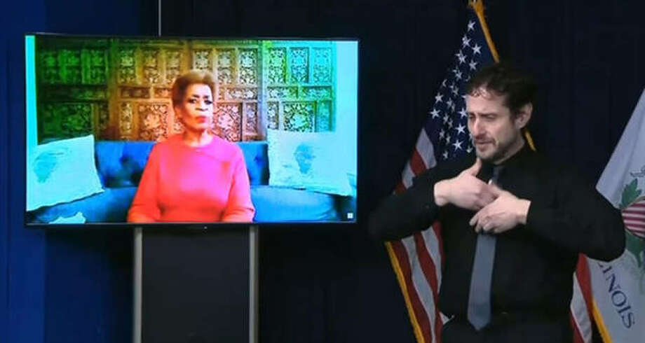 Bonnie Blue, a Chicago resident who took part in a clinical trial of a COVID-19 vaccine, speaks via videoconference during Gov. J.B. Pritzker's daily media briefing Tuesday to encourage everyone to take the vaccine once it becomes available. Photo: Blueroomstream.com