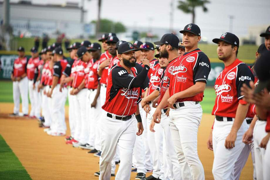 The Tecolotes Dos Laredos are pictured celebrating their first game at Uni-Trade Stadium during a ceremony in 2019. After worries the franchise may be moving to McAllen and Reynosa over issues with concesions, the issues have been resolved, according to officials representing both the city and team. Photo: Danny Zaragoza /Laredo Morning Times File