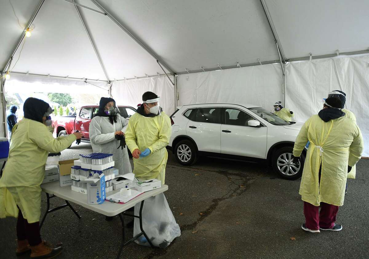 Griffin Hospital employees administer free Covid-19 tests during the opening day of a drive through testing site at Unity Park in Trumbull, Conn. on Tuesday, December 8, 2020. Free testing will be available each Tuesday at the site from 9:30 am to 3 pm.