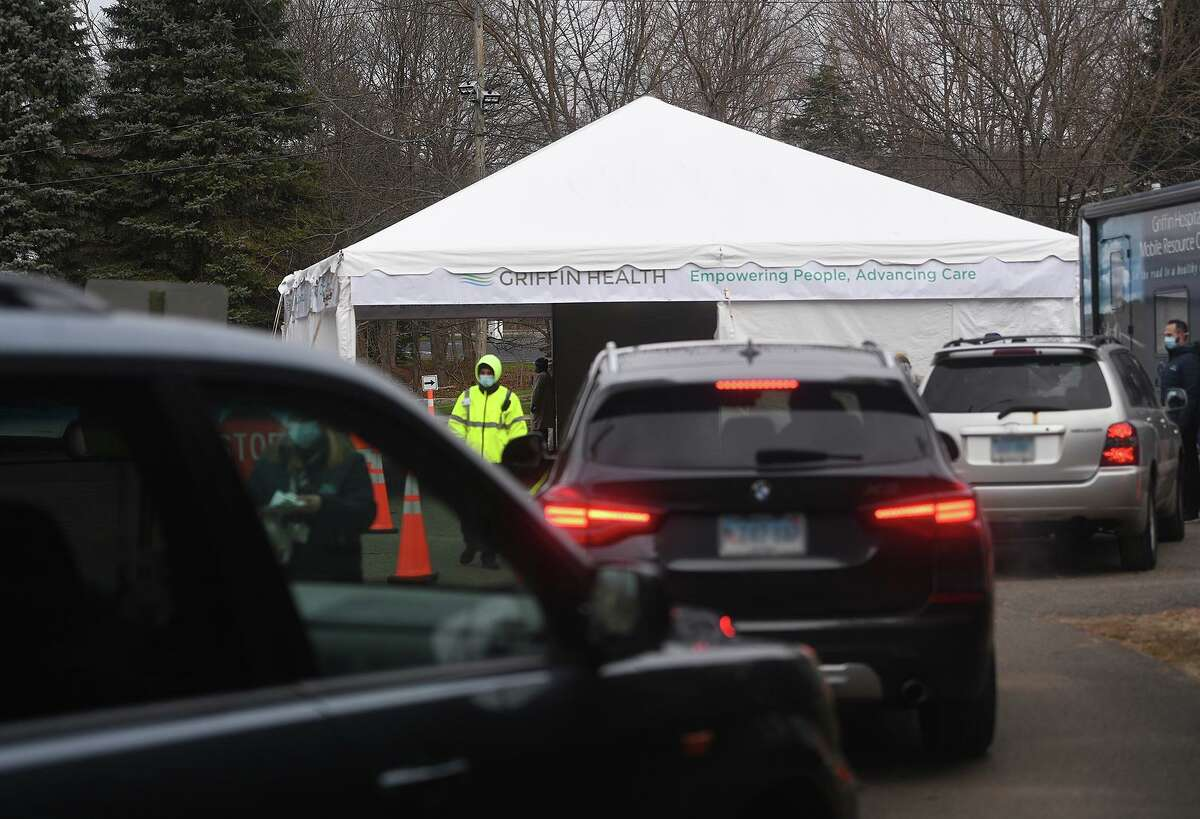 Cars line up for free Covid-19 testing at Griffin Hospital's new drive through testing site at Unity Park in Trumbull, Conn. on Tuesday, December 8, 2020. Testing will be available each Tuesday at the site from 9:30 am to 3 pm.
