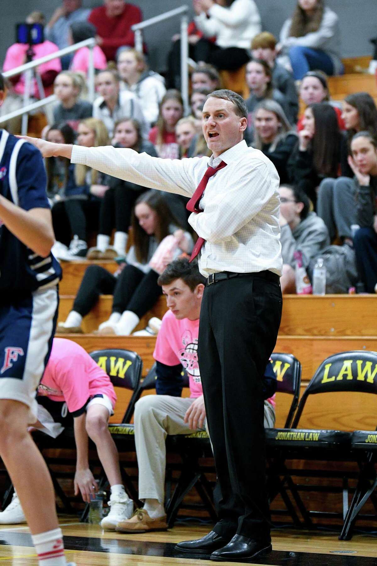 Foran boys basketball coach Ian Kirkpatrick believes letting players take breaks while wearing masks is the way to go.