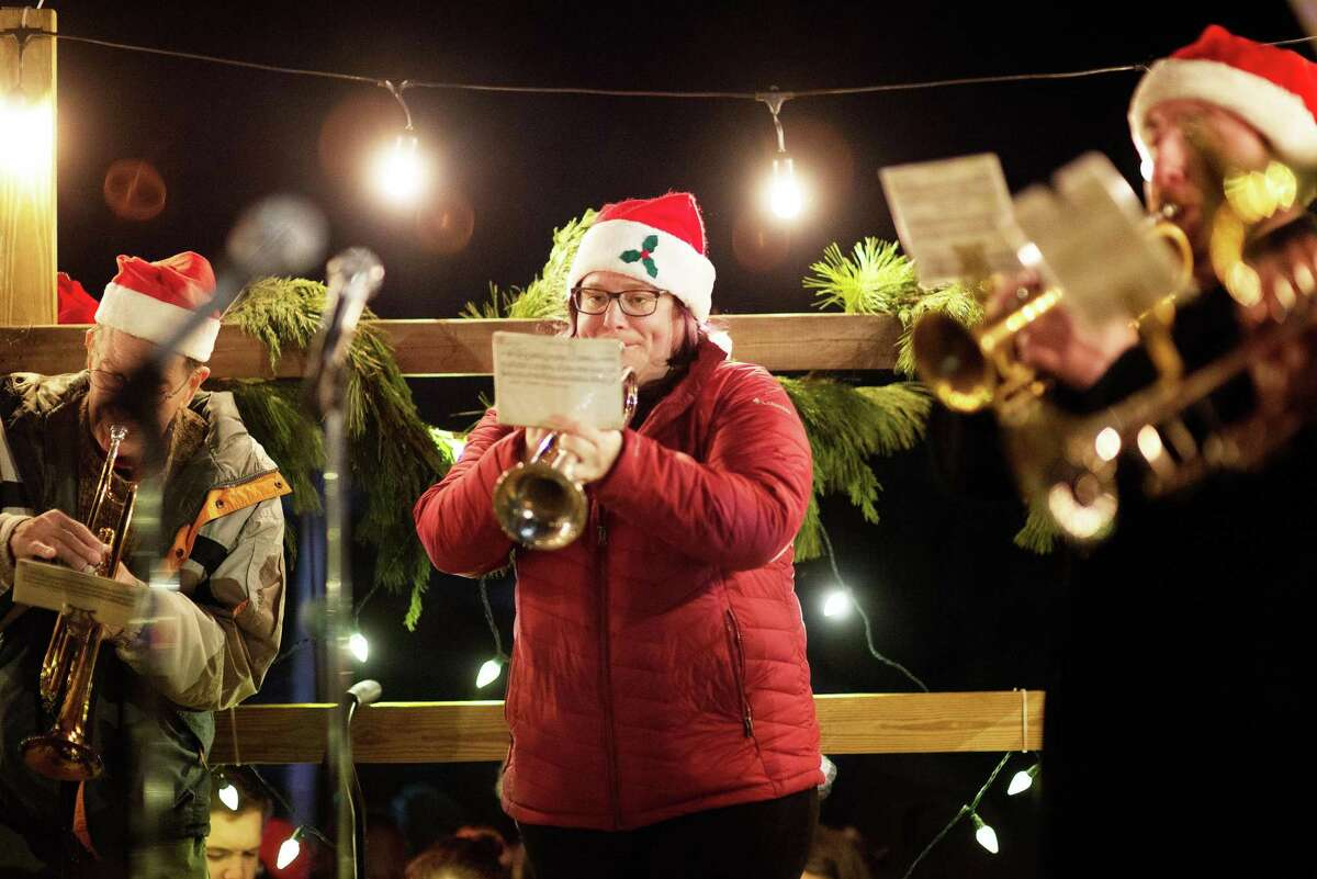 The New Canaan Town Band played while townspeople caroled on Christmas Eve, Dec. 24, 2019, at God's Acre in New Canaan. This year, there will be no caroling Christmas Eve due to COVID-19.