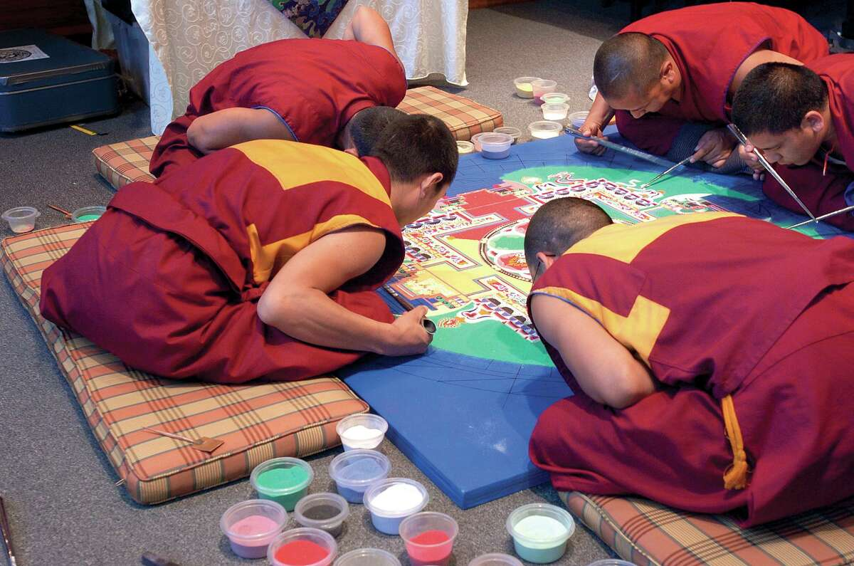 Monks from the Drepung Gomang Monastery in Southern India creating a sand mandala in Greenwich in 2004, which they destroyed after it was finished.