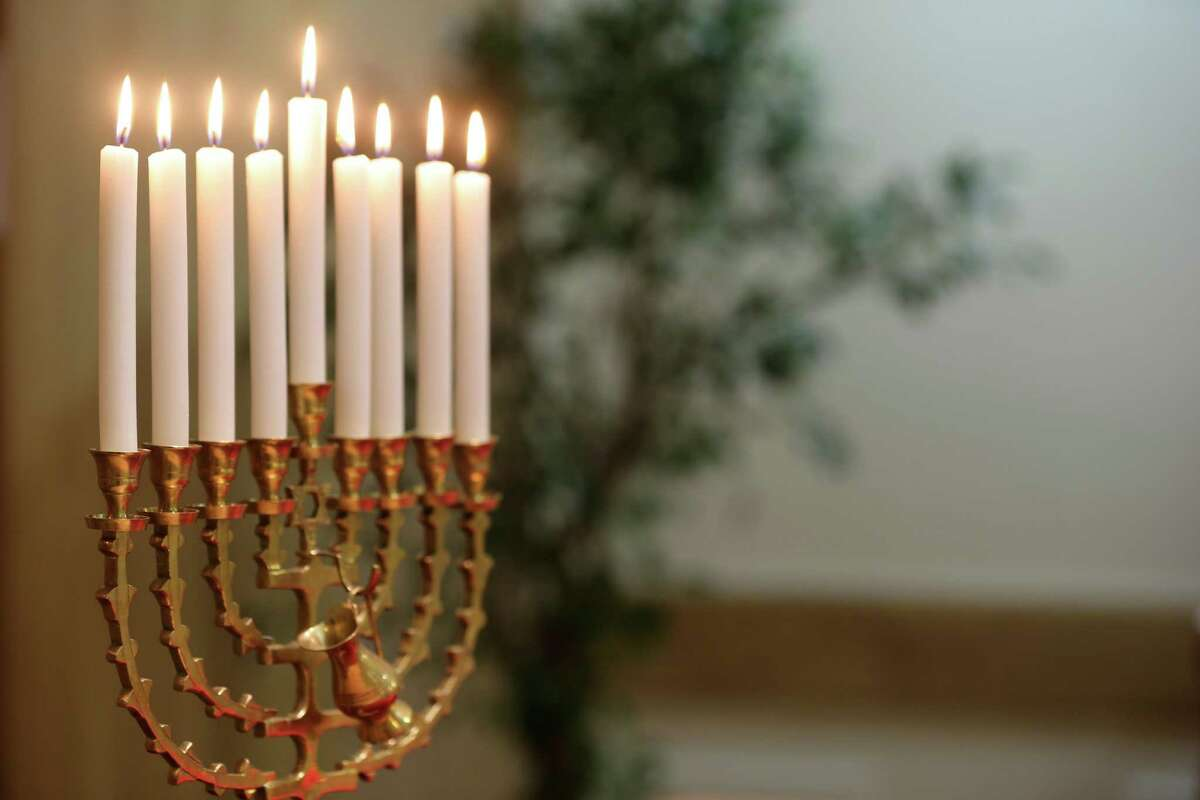 Hanukkha with nine lit candles. (Photo by: Godong/UIG via Getty Images)