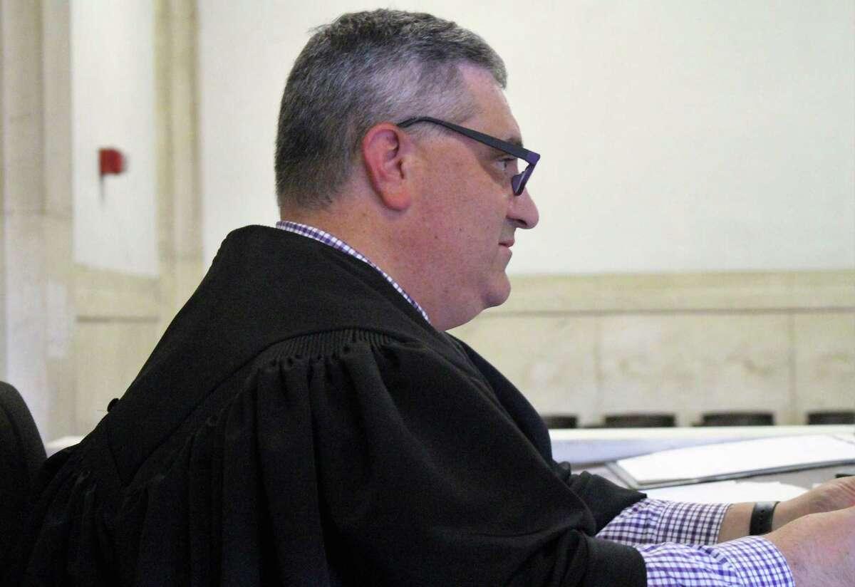Superior Court Judge Walter Spader Jr. presides over eviction hearing