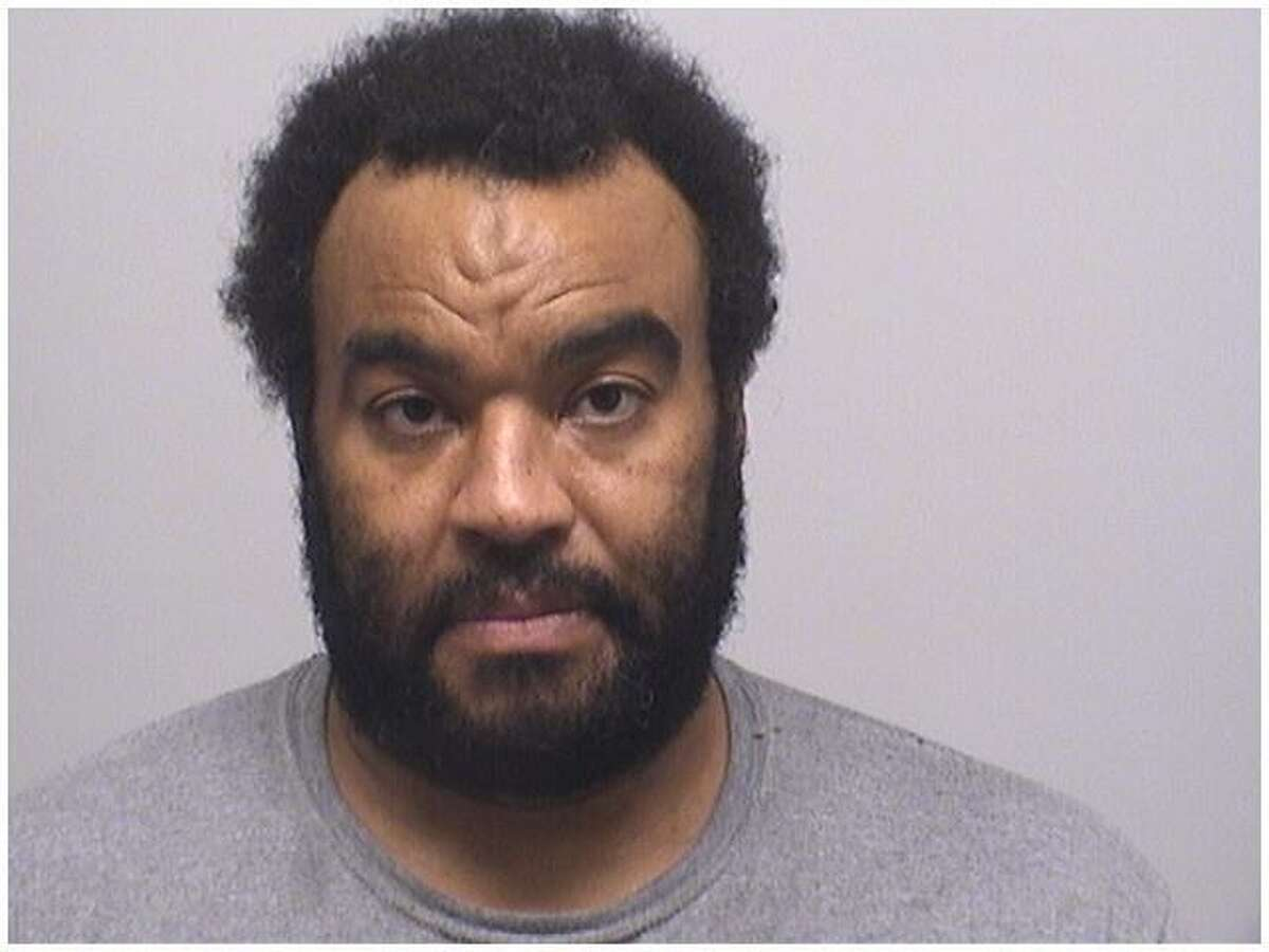 Amin Hasan, 43, of Stamford, was charged with assaulting four police officers while he was found with 65 gallons of gasoline in Stamford on Saturday.