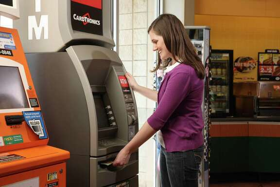 Woman uses a Cardtronics ATM. NCR Corp. landed the Houston ATM company Cardtronics for about $1.7 billion, outbidding two New York investment firms, the companies said Monday.