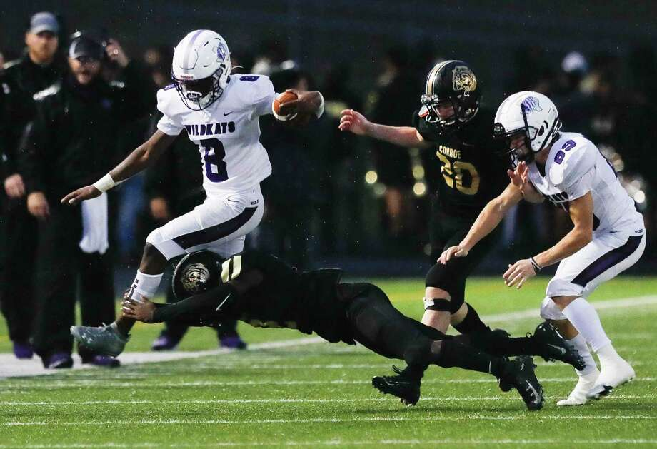 Willis junior Jamarious Wells (8) leaps over a Conroe defender during the third quarter of a District 13-6A high school football game at Buddy Moorhead Stadium, Saturday, Nov. 28, 2020, in Conroe. Photo: Jason Fochtman, Houston Chronicle / Staff Photographer / 2020 © Houston Chronicle