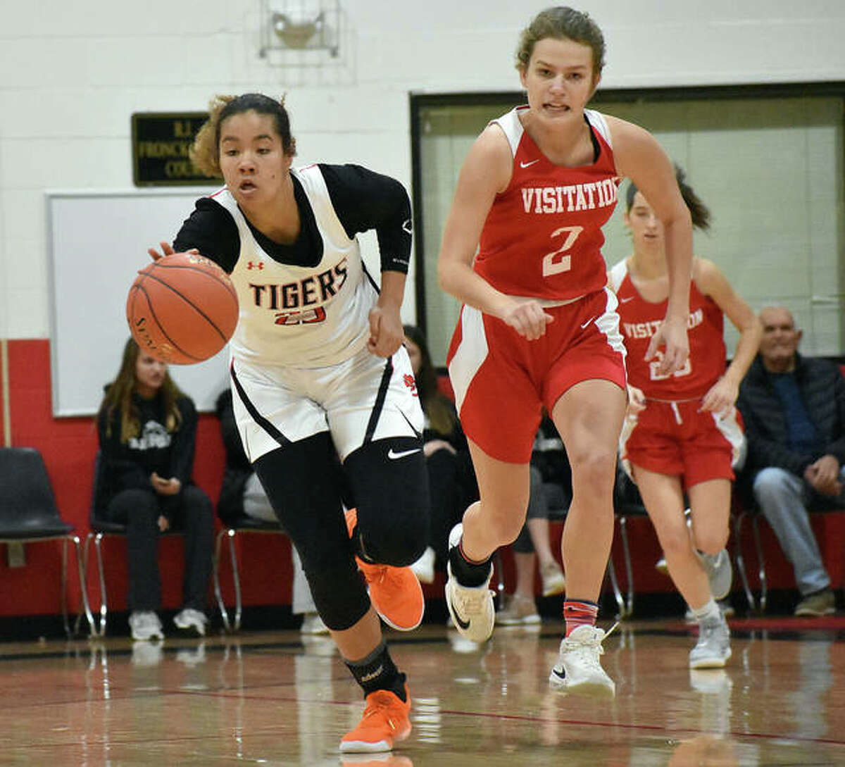 Edwardsville guard Sydney Harris races to the basket after getting a steal near mid-court during Visitation last year in the holiday tournament in St. Louis.