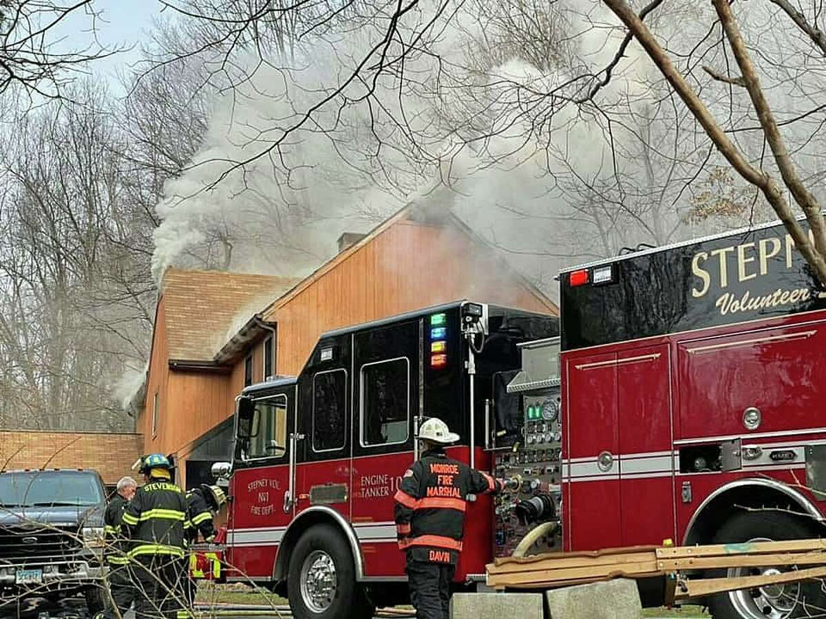 Firefighters battled a fire that heavily damaged a Hattertown Road house on Wednesday, Dec. 9, 2020. Police Lt. Stephen Corrone said