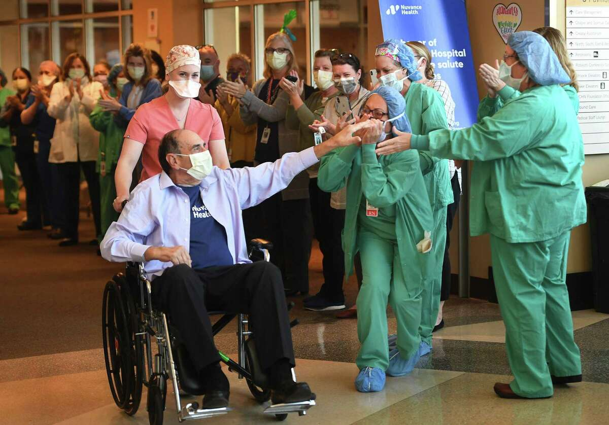 Retired surgeon John Famiglietti, 71, of Brookfield, is cheered by hospital staff as he is released after winning a seven week battle with COVID-19 at Danbury Hospital in Danbury, Conn. on Wednesday, May 13, 2020. COVID-19 personal experience Nearly three-quarters, 74 percent, say they either have been infected themselves or personally know someone who's been infected by the coronavirus. That's a jump of 45 percentage points from April when the question was first asked. Currently, 26 percent say they have not been infected themselves or do not personally know someone who has been infected. Seventy-seven percent say they are either very concerned (46 percent) or somewhat concerned (31 percent) that they or someone they know will be infected with the coronavirus, while 23 percent say they are either not so concerned (13 percent) or not concerned at all (10 percent).