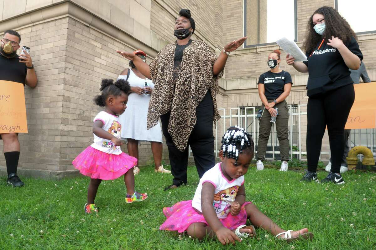 Wanda Simmons, Education Chairperson for the Greater Bridgeport NAACP, speaks at a rally in front of City Hall, in Bridgeport, Conn. July 13, 2020. Simmons is seen here with her granddaughters Ahlahni and Phoenix Younger.