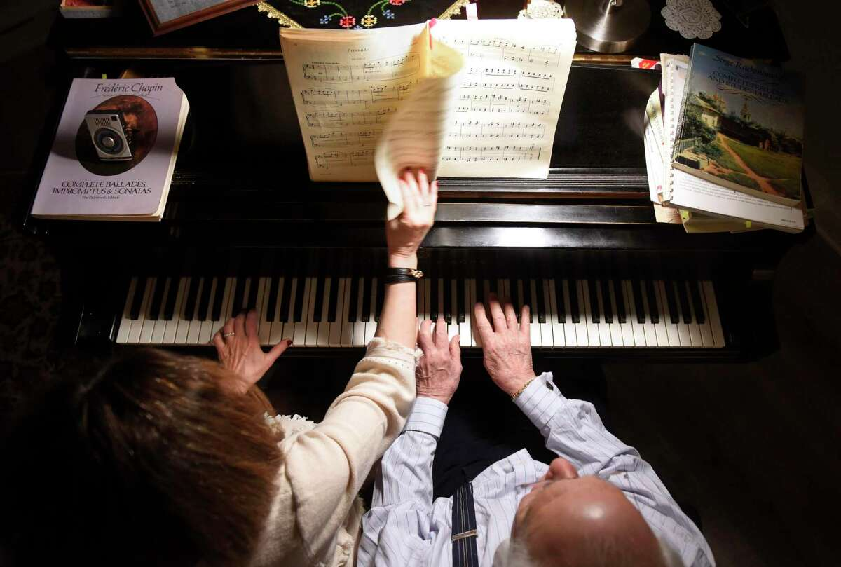 Howard Aibel and Mimi Melkonian play piano in their home in the Cos Cob section of Greenwich, Conn. Wednesday, Jan. 22, 2020. Howard Aibel, a world-renowned pianist, and his wife Mimi Melkonian will be performing a piano duet in an upcoming charity concert on Feb. 28 to raise money for an international piano competition for blind pianists through the Bella Music Foundation nonprofit.