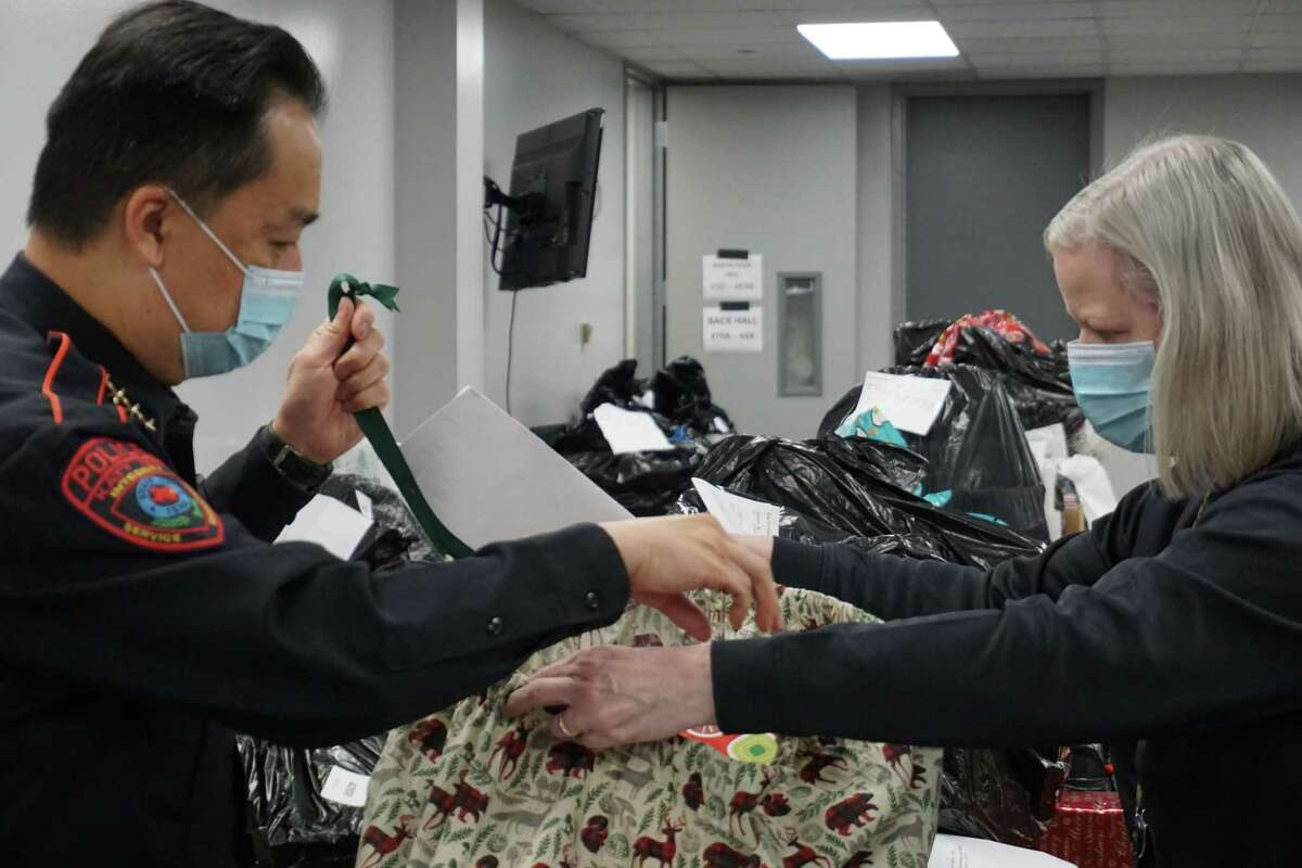 Henry Gaw, Katy Independent School District police chief, left, and Police Specialist Liz Loocke check out gifts ready for a child through the Santa Cops Program on Tuesday, Dec. 8. The program is ready to give clothes and toys to around 1,200 children to help them have a nice Christmas.