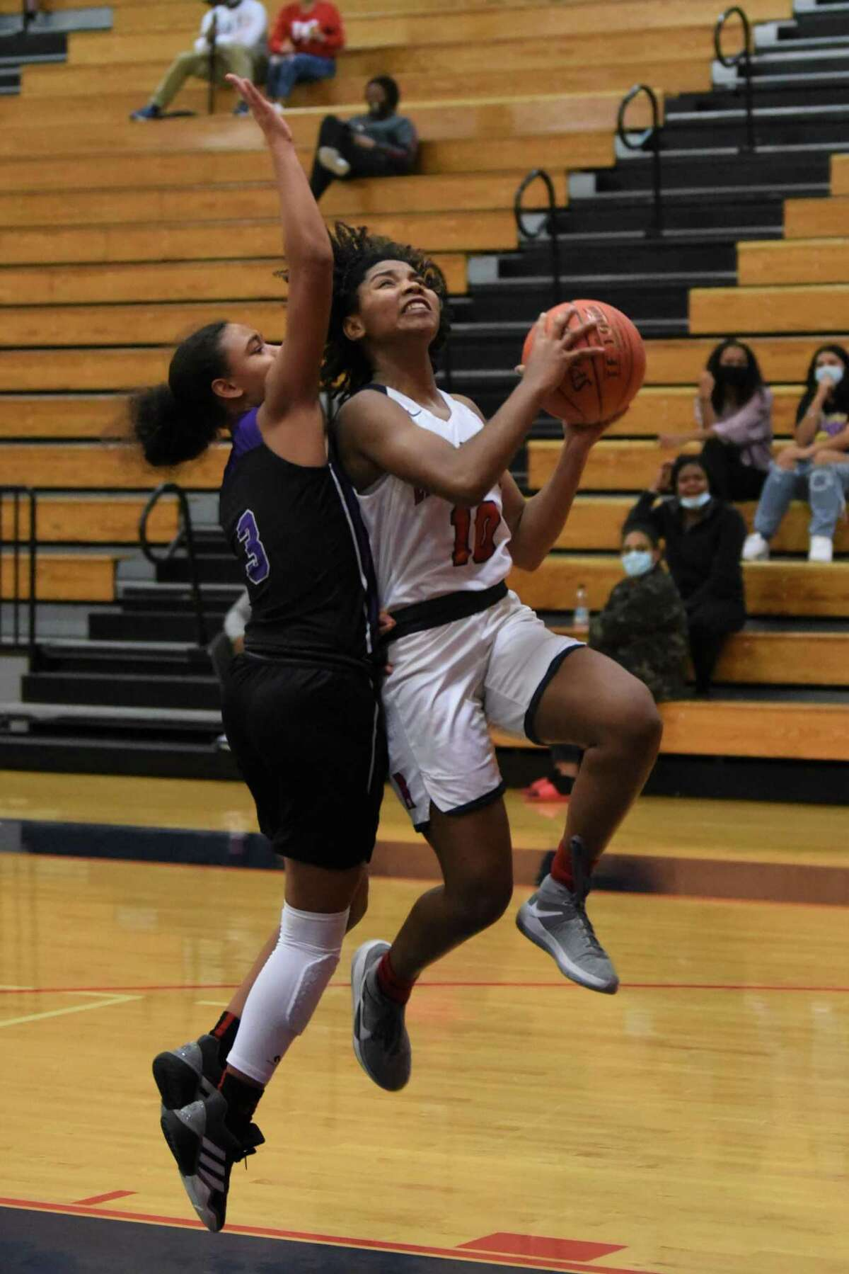 Atascocita senior guard Robin Whitehead goes for a layup agaisnt Humble in a District 21-6A game Tuesday night at the Eagles gym.