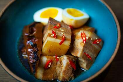 Braised pork belly, bamboo shoots and egg is one of the menu items included with dinner kits at Claws of Mantis, a pop-up restaurant located in Japantown in San Francisco, Calif.