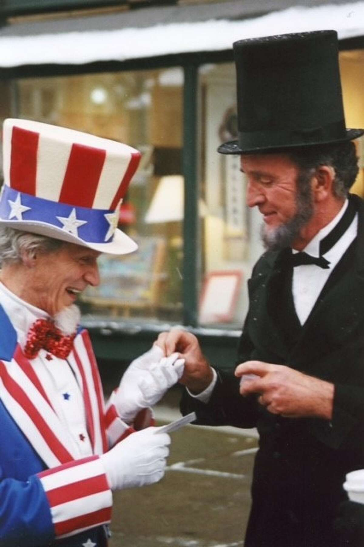 Tim Ball of Scotia caught this shot at the Troy Victorian Stroll many years ago, but it is still one of my favorites.The gentlemen were working the event independently but came upon each other, I believe, for the first time. Ironically, considering the event, they are in the process of exchanging business cards.