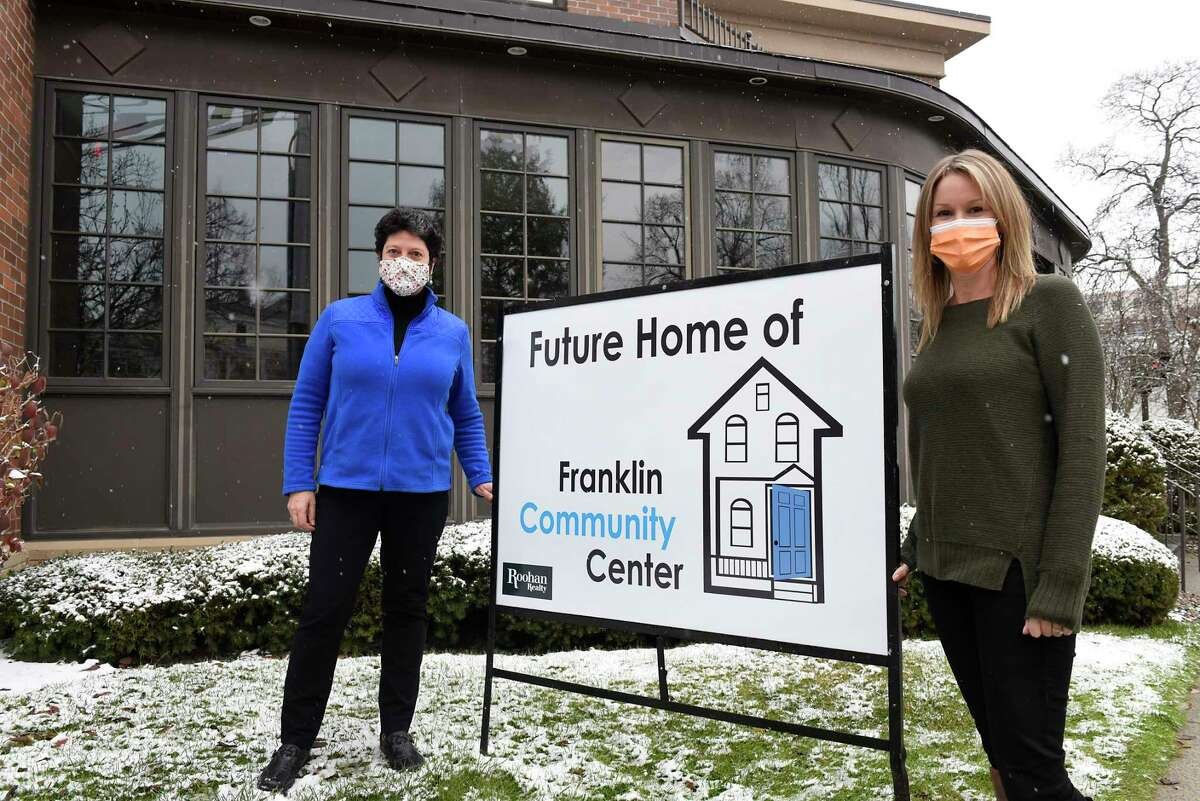Masie Center owner Cathy Masie and Franklin Community Center director Kari Cushing stand outside the Masie Center on Wednesday, Dec. 9, 2020 in Saratoga Springs, N.Y. The Franklin Community Center will be moving into the building. (Lori Van Buren/Times Union)