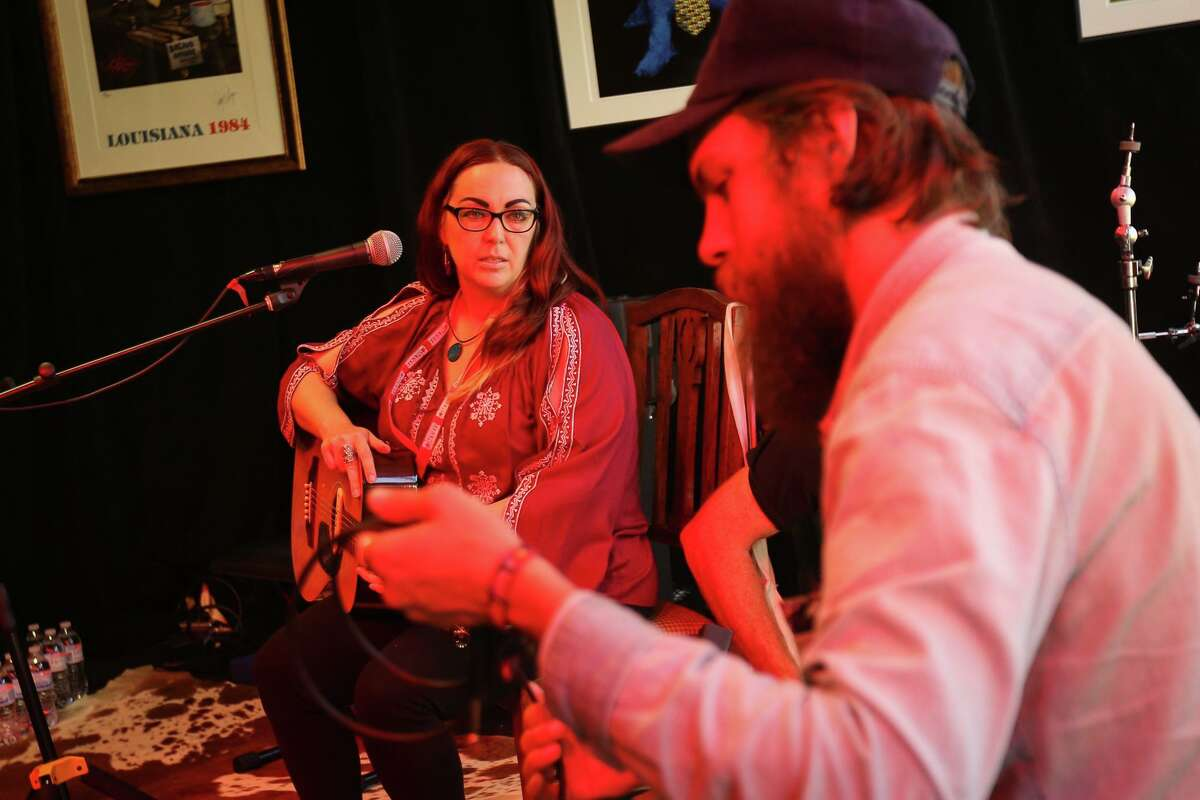 Conroe singer-songwriter Shellee Coley, left, chats with Mason Lankford, of Family Folk Revival, in 2017 in downtown Conroe. On Sunday, they'll be a part of the first Holiday Songwriters Brunch at 202 Main in downtown Conroe.