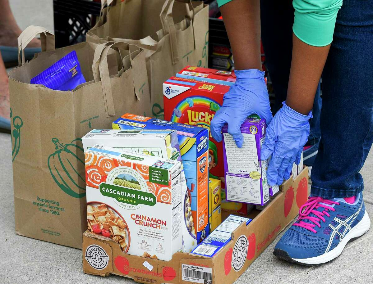 The Greenwich Police Department, partnering with Neighbor to Neighbor, conducts a Community Food Drive on Saturday, May 16, 2020 in Greenwich, Connecticut.