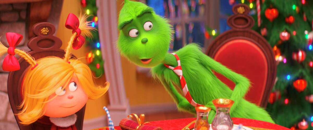 """This file image released by Universal Pictures shows the characters Cindy-Lou Who, voiced by Cameron Seely, left, and Grinch, voiced by Benedict Cumberbatch, in a scene from """"The Grinch."""""""