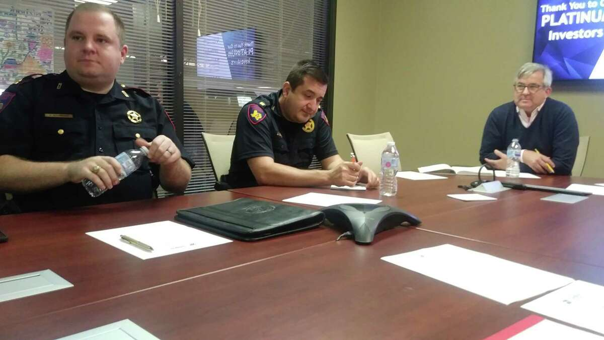 In the photo from before the pandemic, Cpt. Jonathan Zitzmann and Jose Garza with Harris County Precinct 4 Constable's Office discuss local safety and crime happenings with chamber president Bob Lieb during a meeting of the Safety and Security Task Force of the Houston Northwest Chamber of Commerce.