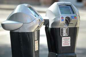 The City of Bridgeport began installing replacement parking meters on downtown streets Wednesday, Aug. 22, 2018.