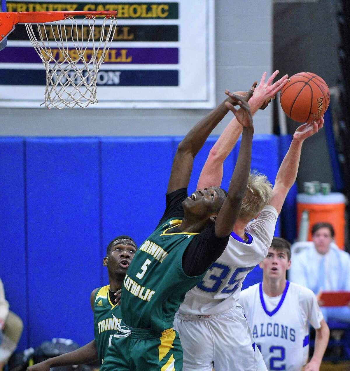 Fairfield Ludlowe's Rowan Keeser (35)grabs a rebound from Trinity Catholic's Rassoul Abakan (5) in a FCIAC boys basketball game on Jan. 14, 2020 in Fairfield, Conn. Fairfield Ludlowe won 68-60.