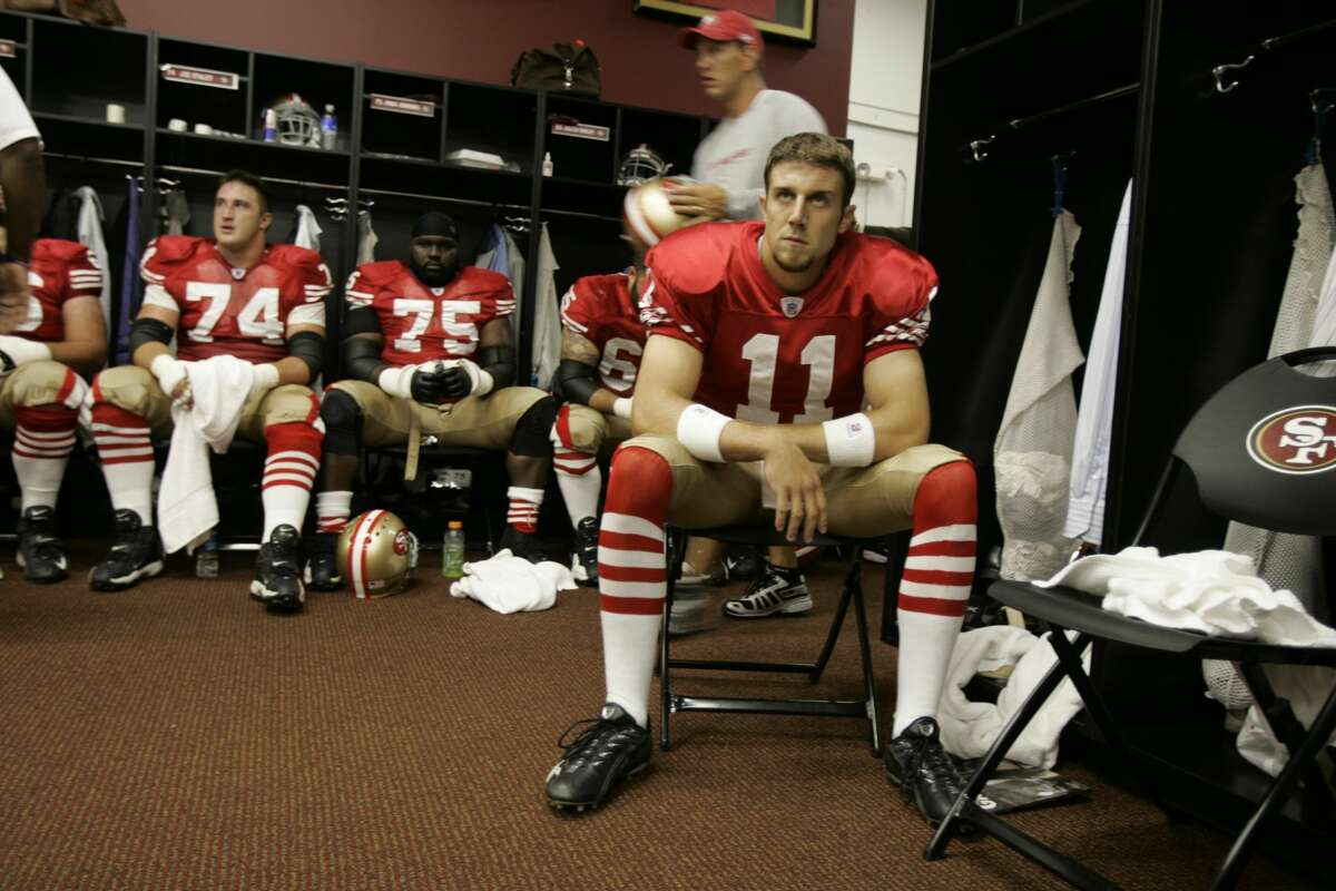 Alex Smith, right, of the San Francisco 49ers looks on in the locker room before a NFL Monday Night Football game against the Arizona Cardinals on Sept. 10, 2007, in San Francisco.