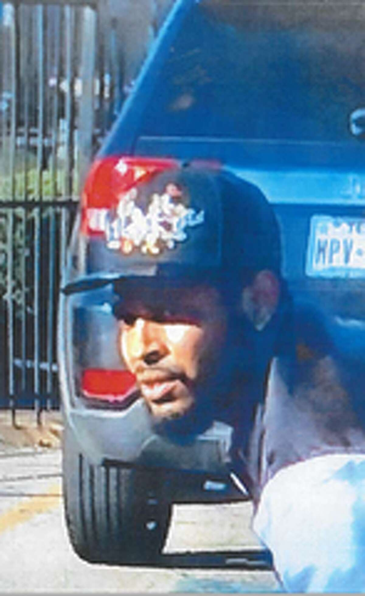 The Harris County Sheriff's Office on Wednesday released surveillance images of a person of interest and a vehicle tied to the murder of Cory Crawford in northwest Harris County.