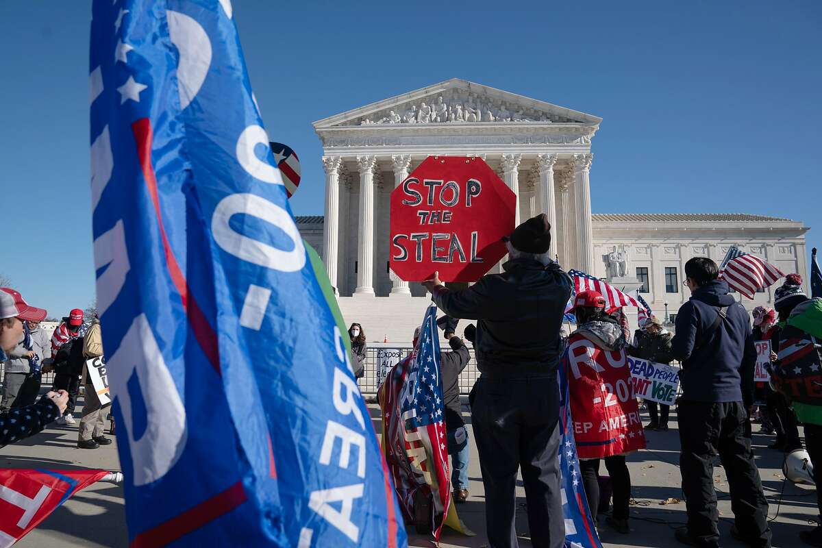 Supporters of President Trump rallied outside the Supreme Court Tuesday before it threw out a case seeking to invalidate millions of votes in Pennsylvania.