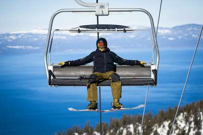 Single lift riders can opt to ride by themselves or spread two people out on a chair on opening day at Heavenly Mountain Resort in South Lake Tahoe, California, November 20, 2020.