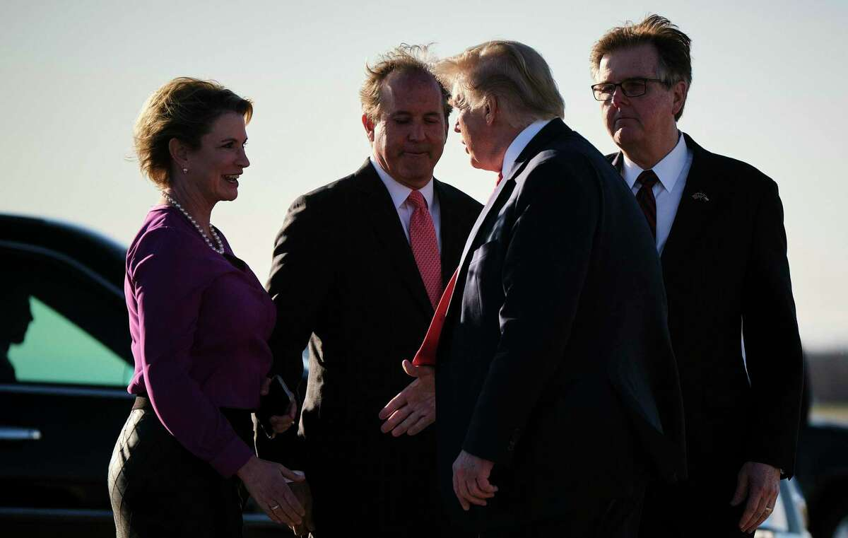 FILE -- President Donald Trump is greeted by Ken Paxton, second left, the attorney general of Texas, and others upon arrival in Austin, Jan. 19, 2020. An architect of Texas Republicans' aggressive conservative agenda, Paxton now stands accused of wrongdoing by his own aides and faces calls for his resignation. (T.J. Kirkpatrick/The New York Times)