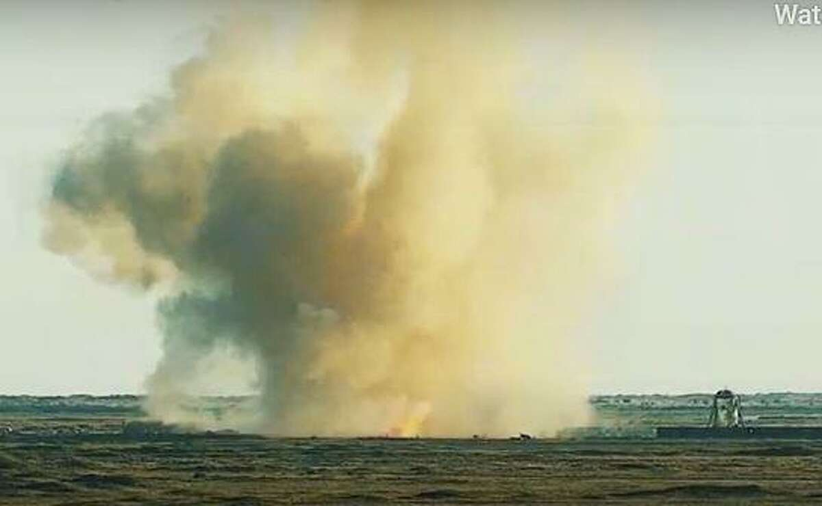 This SpaceX video frame grab image shows SpaceX's Starship SN8 prototype exploding right next to its landing pad at the company's Boca Chica, Texas facility during an attempted high-altitude launch test on December 9, 2020. - SpaceX came within seconds of attempting to launch the latest prototype of its next-generation Starship rocket, until an engine issue stopped the company short of liftoff on December 8, 2020. (Photo by Olivier DOULIERY / SPACEX / AFP) /