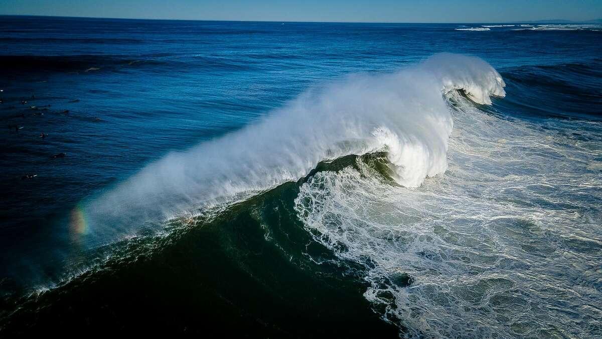 Surfers take on a huge swell at Mavericks on December 8, 2020 in Halfmoon Bay, Calif.