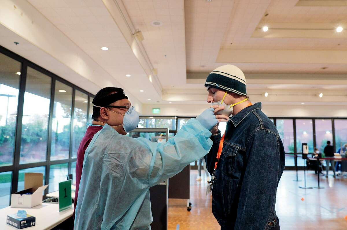 Julio Blanco, RN, inserts a nasal swab in Danny Gerz's nostril during COVID-19 testing at the Mexican Heritage Plaza in San Jose, Calif., on Monday, November 23, 2020. Thirty-one percent (31%) of the COVID-19 cases in Santa Clara County are located within five ZIP codes in East San Jose. The Mexican Heritage Plaza, located in the heart of East San Jose, has been a coronavirus testing site every Wednesday since August in partnership with Gardner Health Services and Santa Clara County. On Monday, they will host additional testing hours ahead of the Thanksgiving holiday.