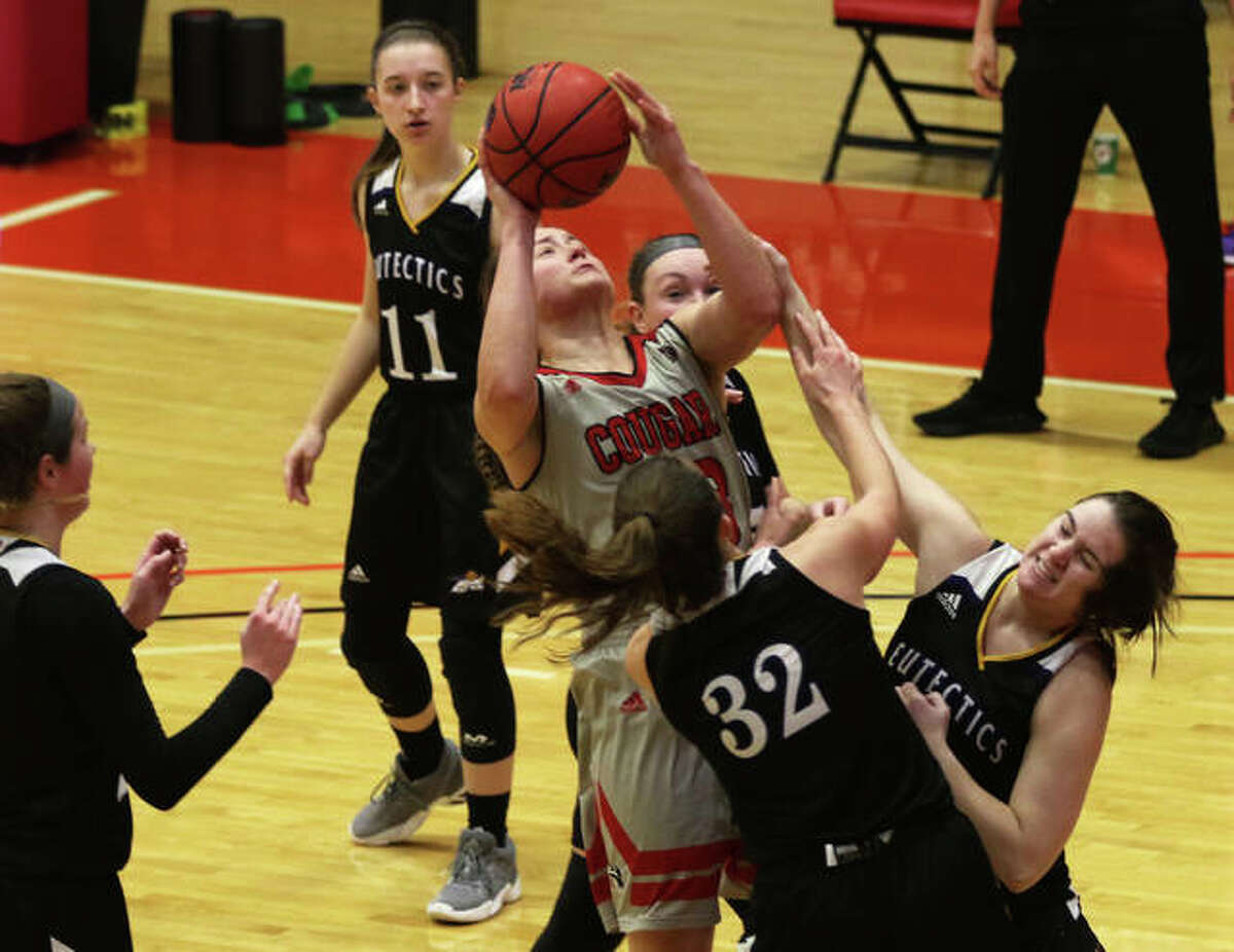 SIUE's Allie Troeckler (middle) is surrounded by five Eutectics and draws a foul from one while making the basket and converting a three-point play during the second quarter Wednesday at First Community Arena in Edwardsville.