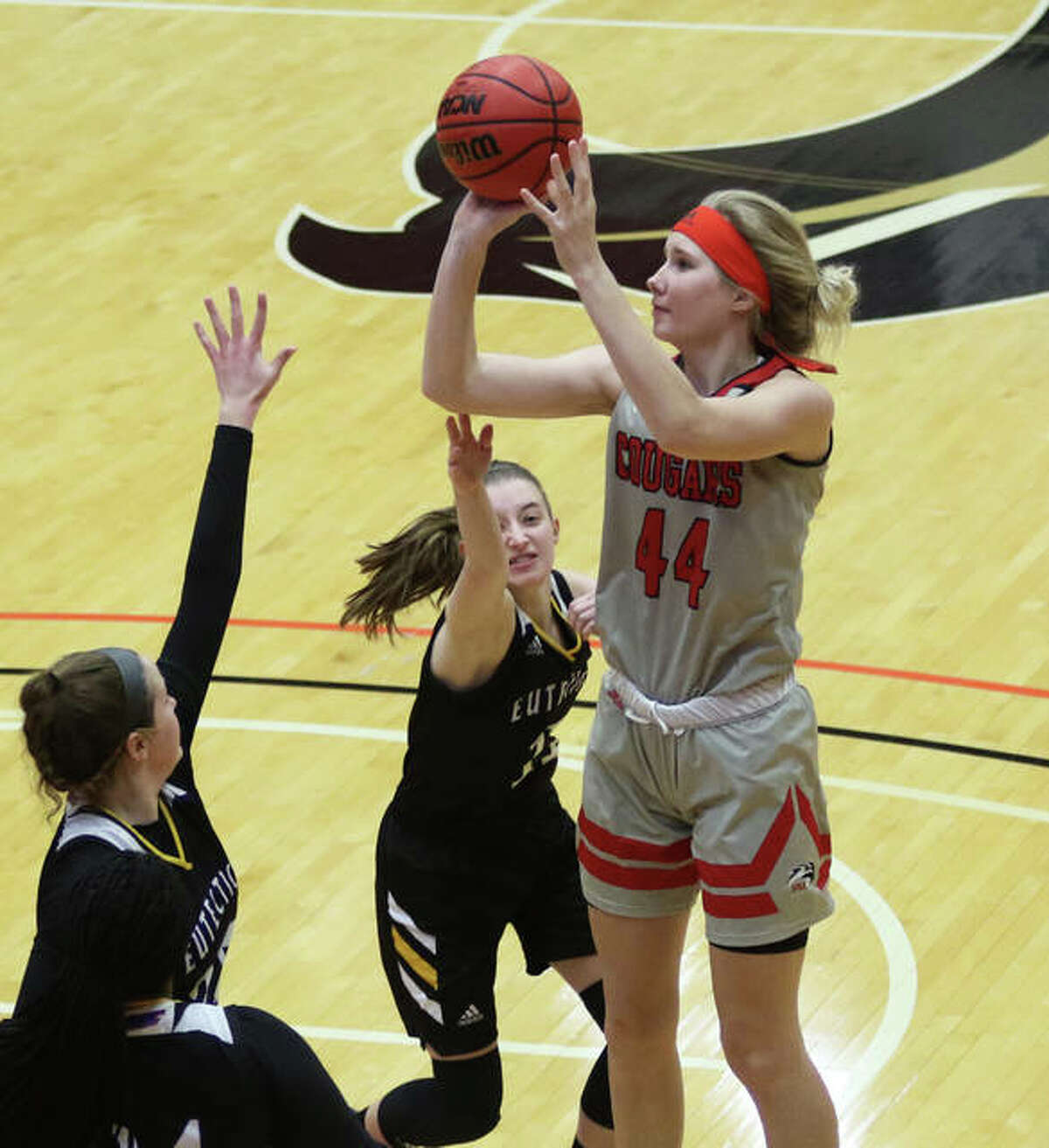 SIUE's Tori Hamilton (44), a 6-foot-5 freshman from Paris, Missouri, puts up a shot over two UHSP defenders Wednesday at First Community Arena in Edwardsville.