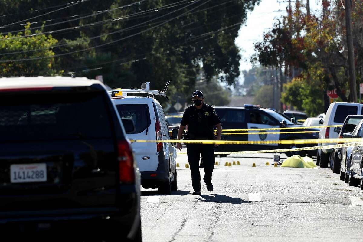 The Oakland Police Department investigates a fatal shooting in the 1900 block of 84th Ave. in Oakland, Calif., on Wednesday, October 14, 2020. One victim was a 19-year-old male who went by the nickname Lalo. The event left three shooting victims, with two fatalities. This incident marks the 77th and 78th homicides of the year in Oakland.