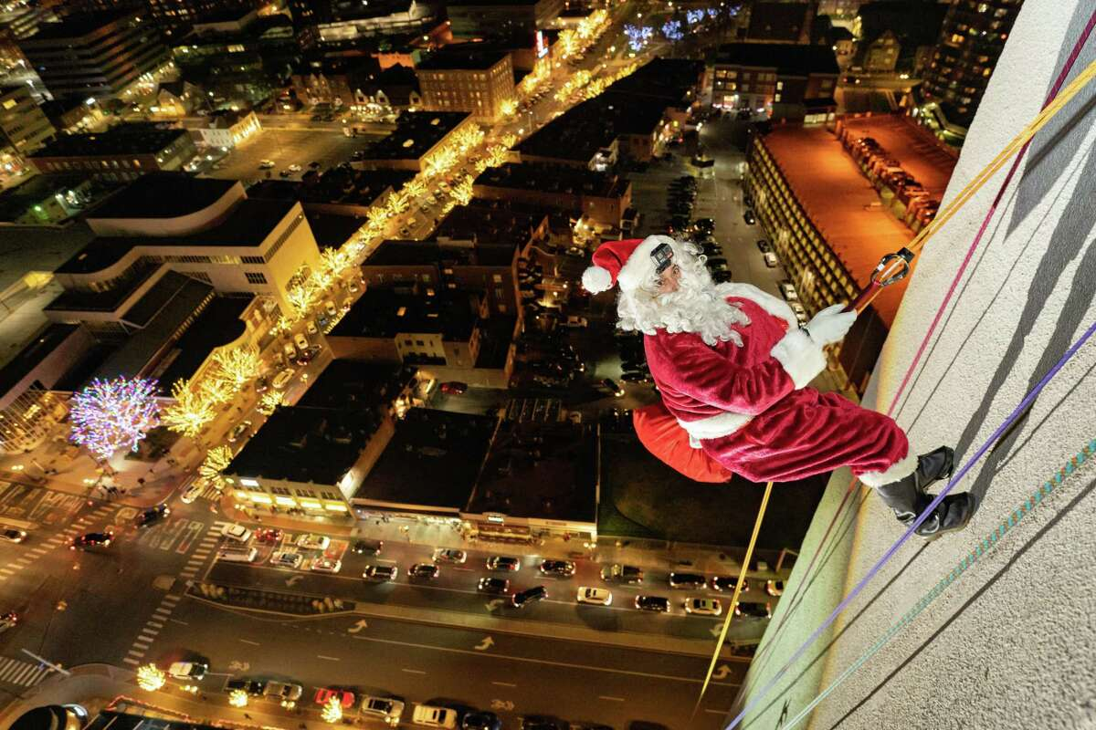Santa rappelled down One Landmark Square a few days early for this year's Heights and Lights event in Downtown Stamford. YES Network, the New York Yankees' television channel, will broadcast the annual celebration and tree lighting in lieu of the in-person event.