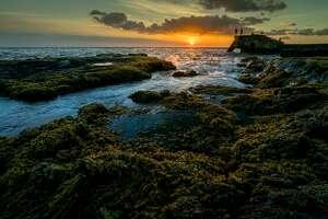 Unforgettable golden sunset over the beautiful coastline of Wawaloli Beach Park Kona Kohala Hawaii. The beauty of the turquoise coastal beaches of Hawaii are almost indistinguishable from those of the Bahamas, French Polynesia, Malau, Hawaii, Cancun, Costa Rica, Florida, Maldives, Cuba, Fiji, Bora Bora, Puerto Rico, Honduras, or other tropical vacation travel destinations.