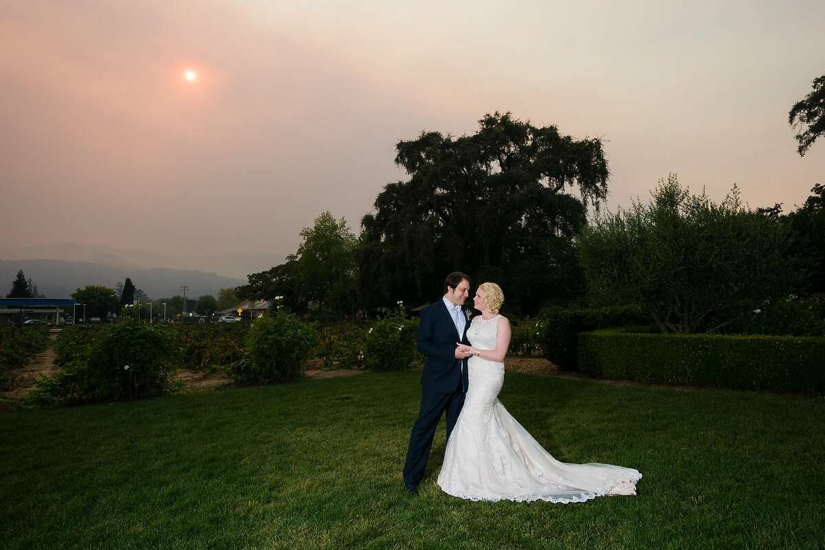 The sky was hazy because of wildfires, including the Tubbs Fire, on the day of Cindy and Aaron Weisberg's October 2017 wedding.