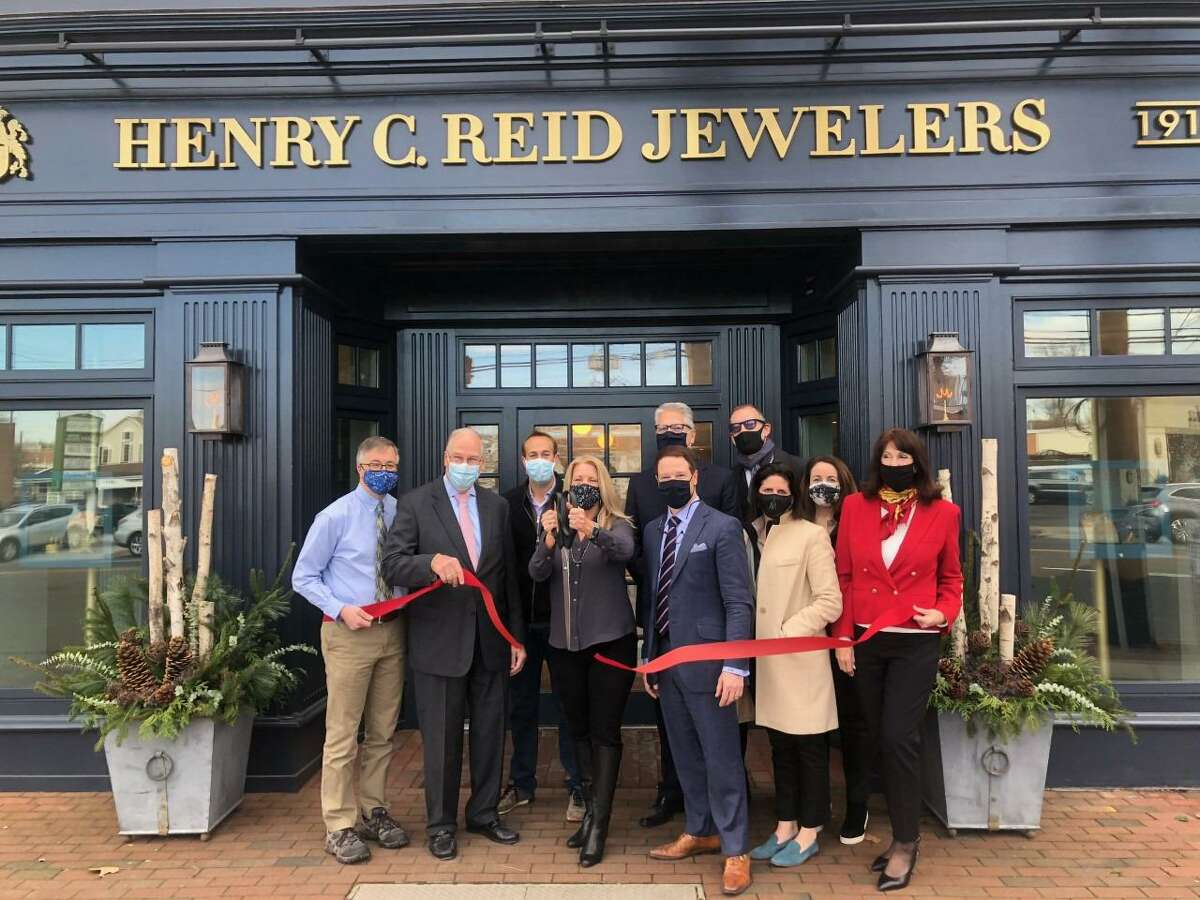 Local officials including Fairfield First Selectwoman Brenda Kupchick and other local officials are in attendance to cut the ribbon at the ribbon cutting ceremony for the re-opening of the family owned, and 110-year-old Fairfield business Henry C. Reid Jewelers Dec. 4.