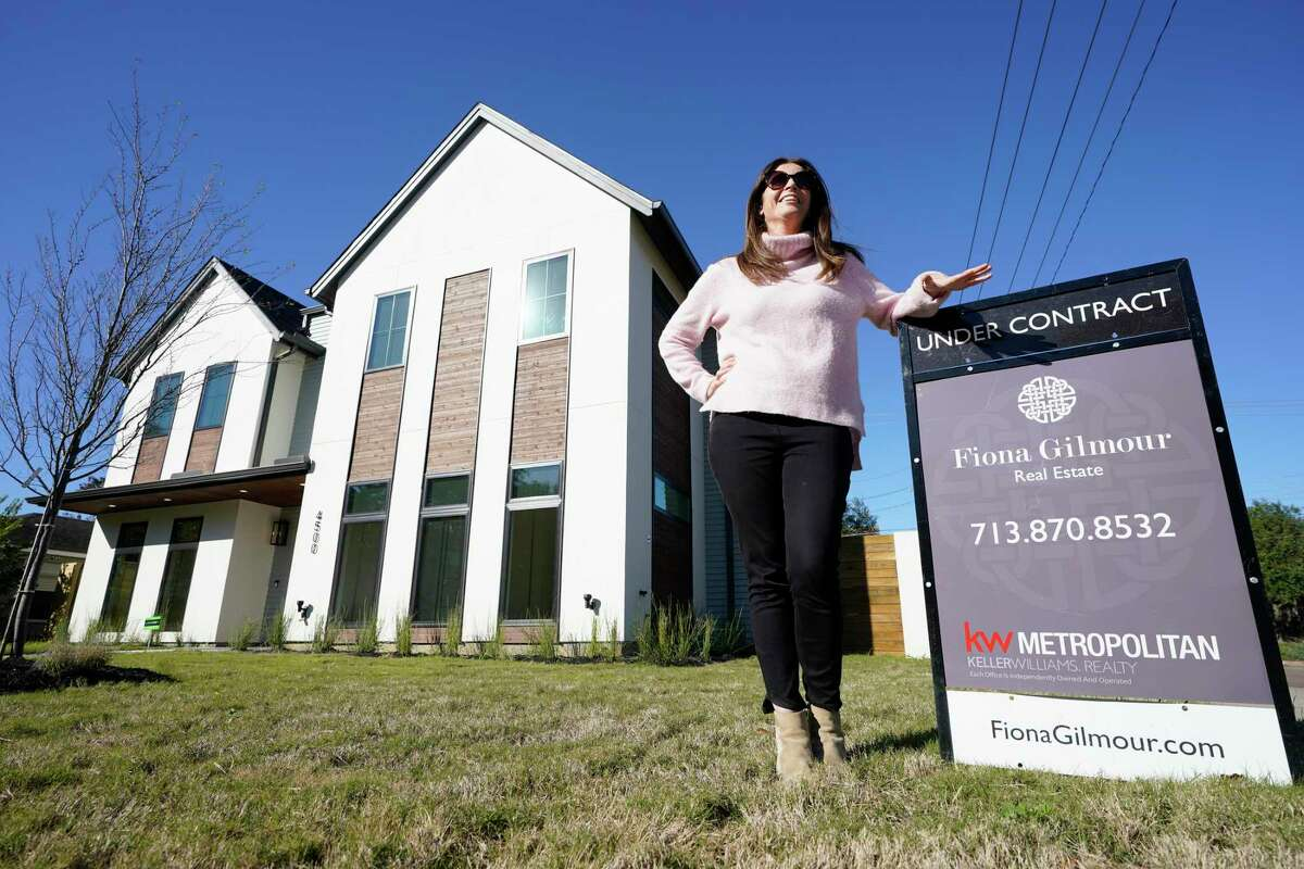 Fiona Gilmour, a Realtor with Keller Williams Realty Metropolitan, is shown outside one of her listings Wednesday, Dec. 9, 2020 in Bellaire. She takes precautions such as asking buyers about their travel and their exposure to COVID before showings.