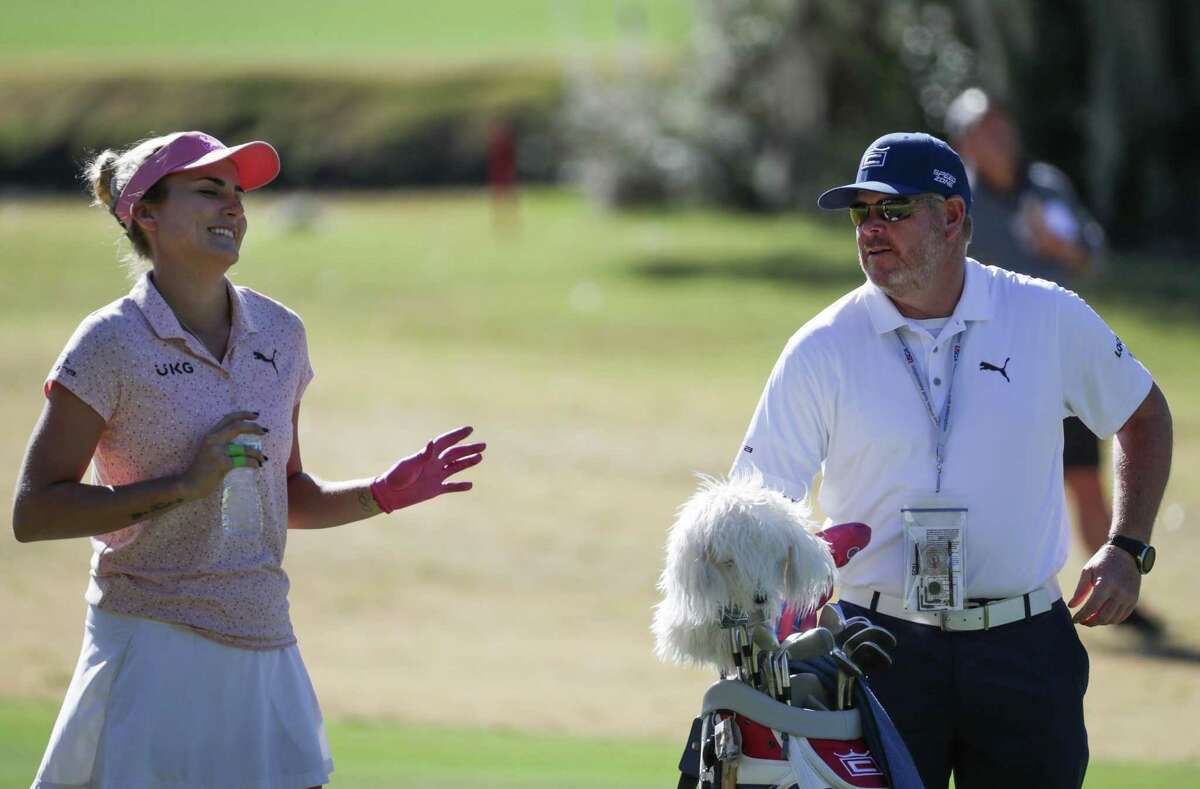 Lexi Thompson and caddie Tim Tucker share a moment on the fairway during Wednesday's practice round for the U.S. Women's Open.