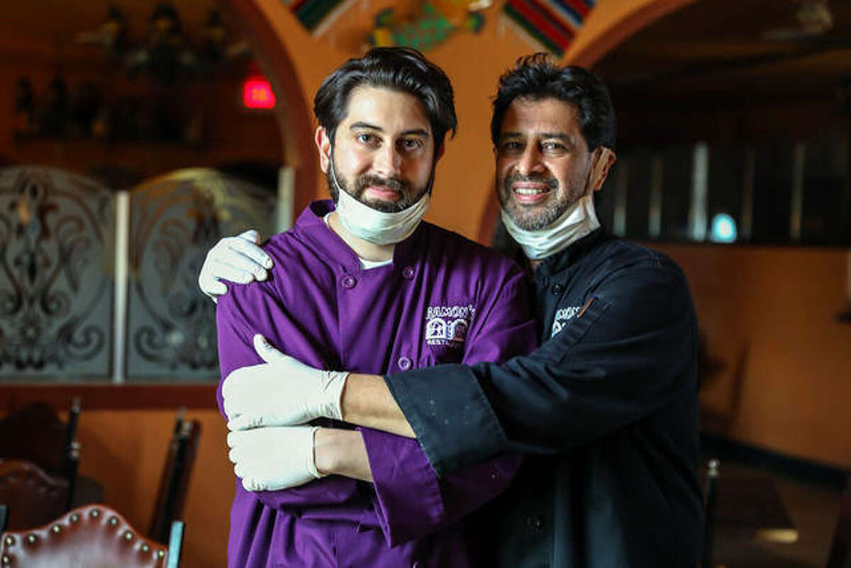 """Carlos Otero Sr., right, the current manager of Ramon's El Dorado in Collinsville, with his son, Carlos Otero Jr. Saturday's third annual """"Give to Remember"""" Alzheimer's Benefit at Ramon's will honor the memory of the late Raymundo """"Ramon"""" Otero, the founder of the restaurant."""