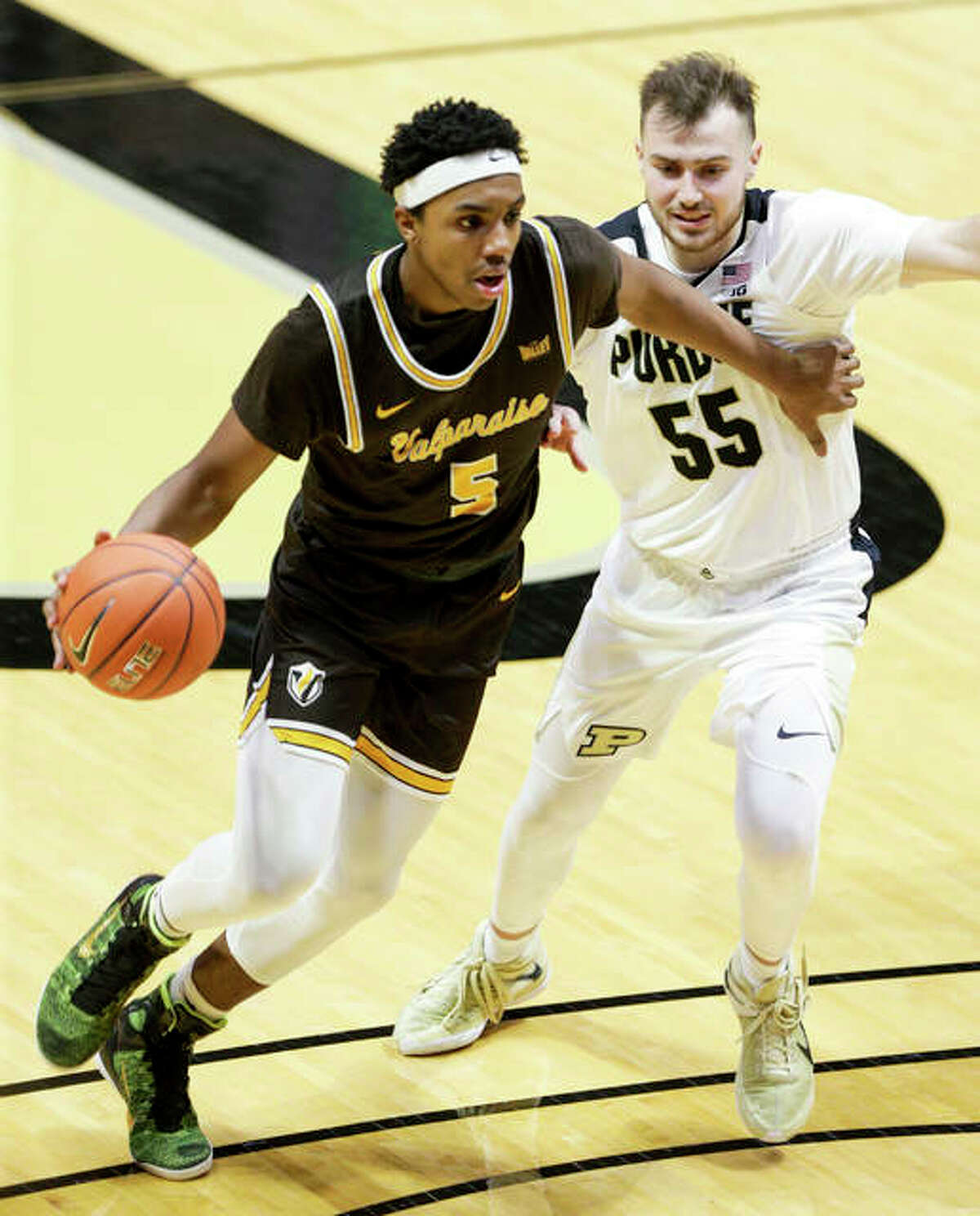 Valpo's Donovan Clay (left), shown dribbling past Purdue's Sasha Stefanovic in a game last Friday in West Lafayette, Ind., scored six points in Wednesday's victory over SIUE in Valparaiso, Indiana.