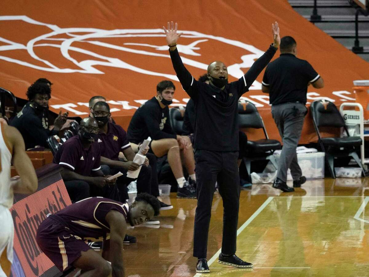 Texas State coach Terrence Johnson gestures to players during the second half of the team's NCAA college basketball game against Texas, Wednesday, Dec. 9, 2020, in Austin, Texas. (AP Photo/Michael Thomas)