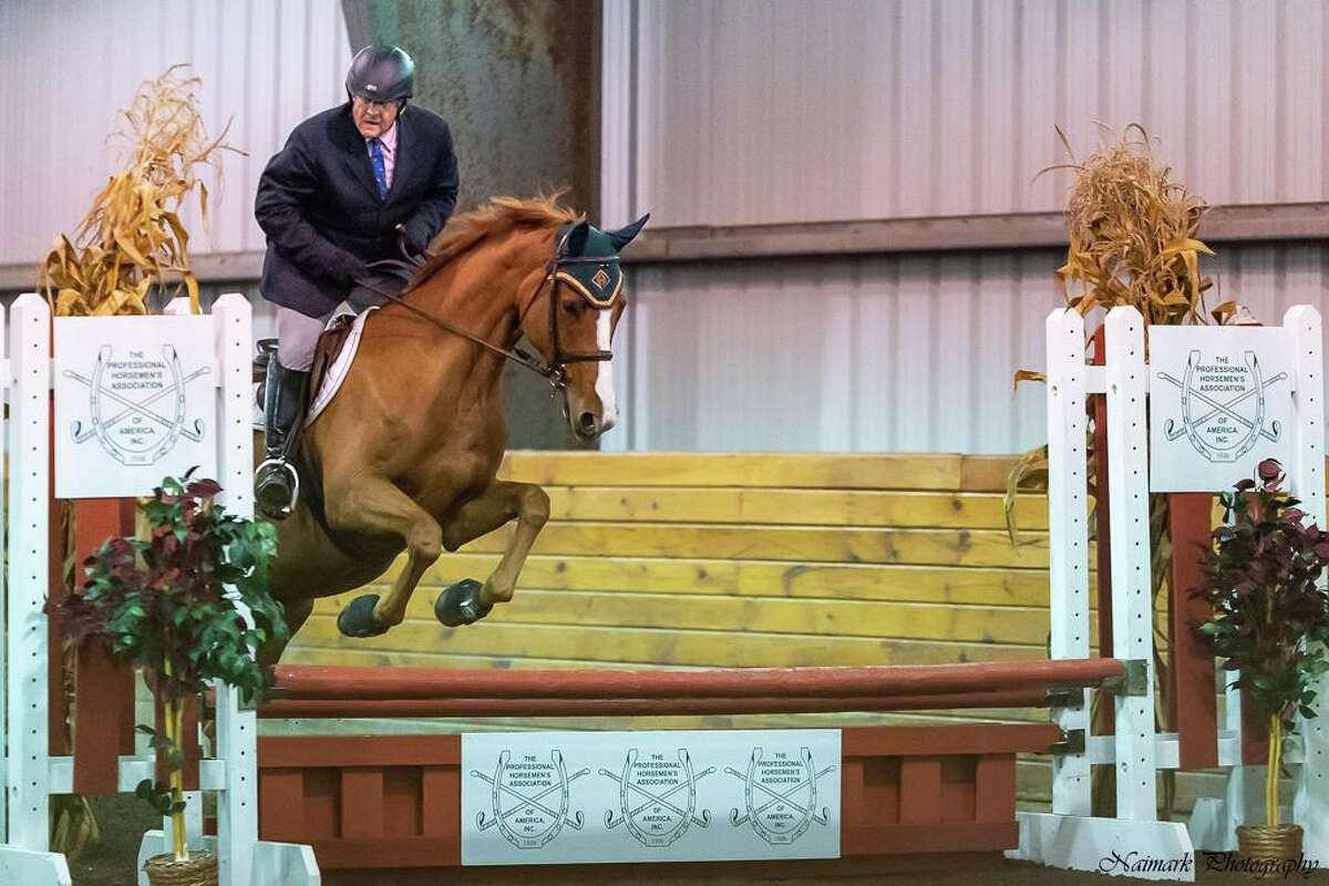 """Bob Rose, a longtime Westport resident, and Starbuck Equestrian's Rio's Latte decisively won the 2020 Professional Horsemen Association's National Invitational Championship in the Jumper Division. Rose also won the 2020 Fairfield-Westchester Professional Horsemen Association's (FW-PHA) Championship ribbon in the 3' Training / Schooling Jumper Division and was Reserve Champion in both the FW-PHA's Child Adult Jumper Division and the 2'6"""" Training / Schooling Jumper Division. He is a member Starbuck Equestrian's show team. His trainers throughout the year were Amanda and Juliana Starbuck."""