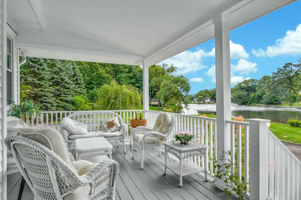 A pond view from the porch/balcony at 71 Goodwives River Road in Darien. The 3,400-square-foot house sits on a level property of 1.11 acres with about 400 feet of direct waterfront. Gorham's Pond provides the homeowners with views of the tranquil waterway and the wildlife that it attracts, including graceful swans and an occasional majestic eagle. At the southern end of the property there is a boathouse and an area to launch a kayak or canoe.